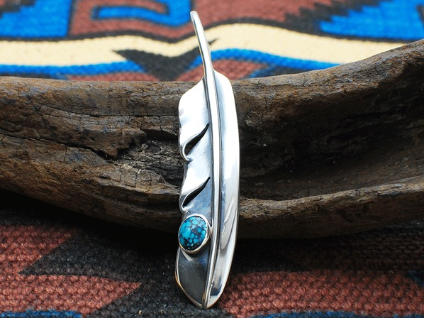.WING FEATHER WITH TURQUOISE.