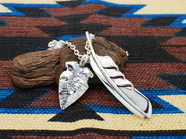 .WING FEATHER & ARROW HEAD.